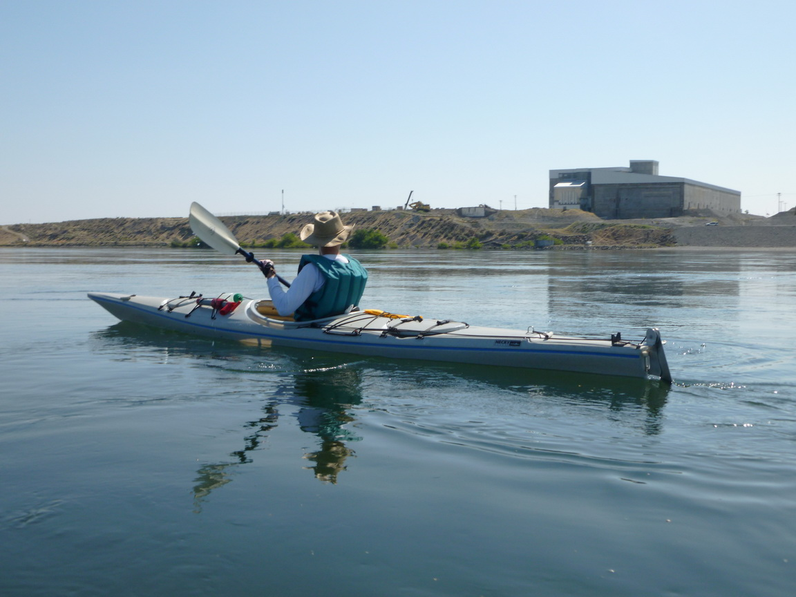 Bruce Hunt paddling by B reactor, Hanford Reach